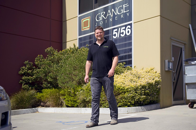 Business-Owner-outside factory shop Grange