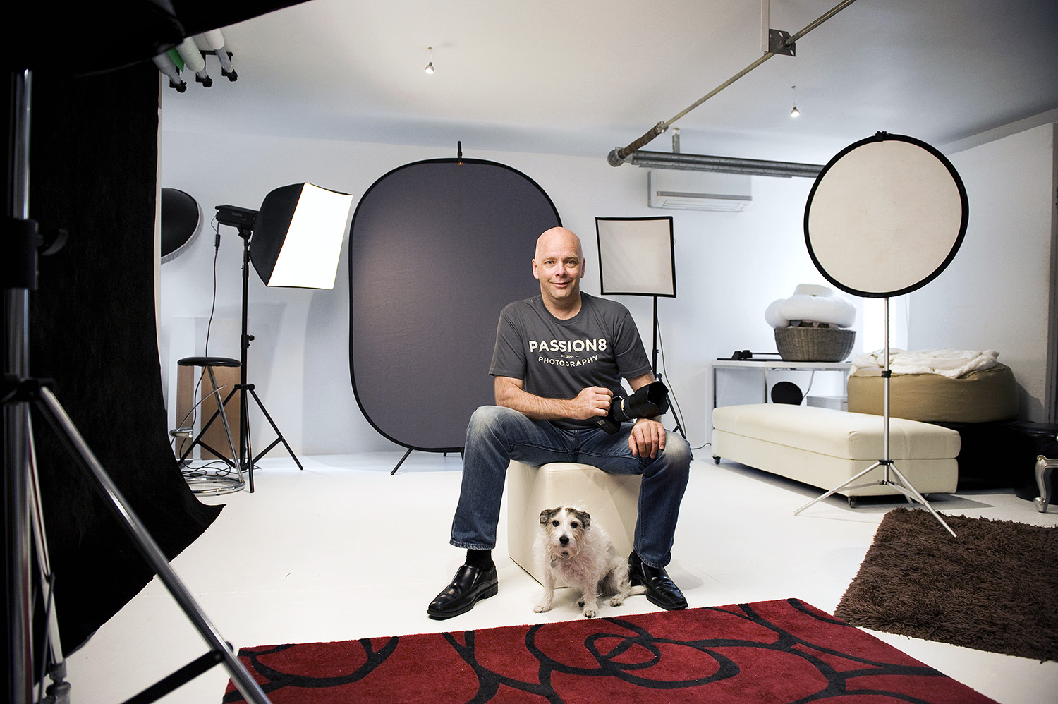 Photographer Andrew Harrison in his home studio with his scruffy assistant