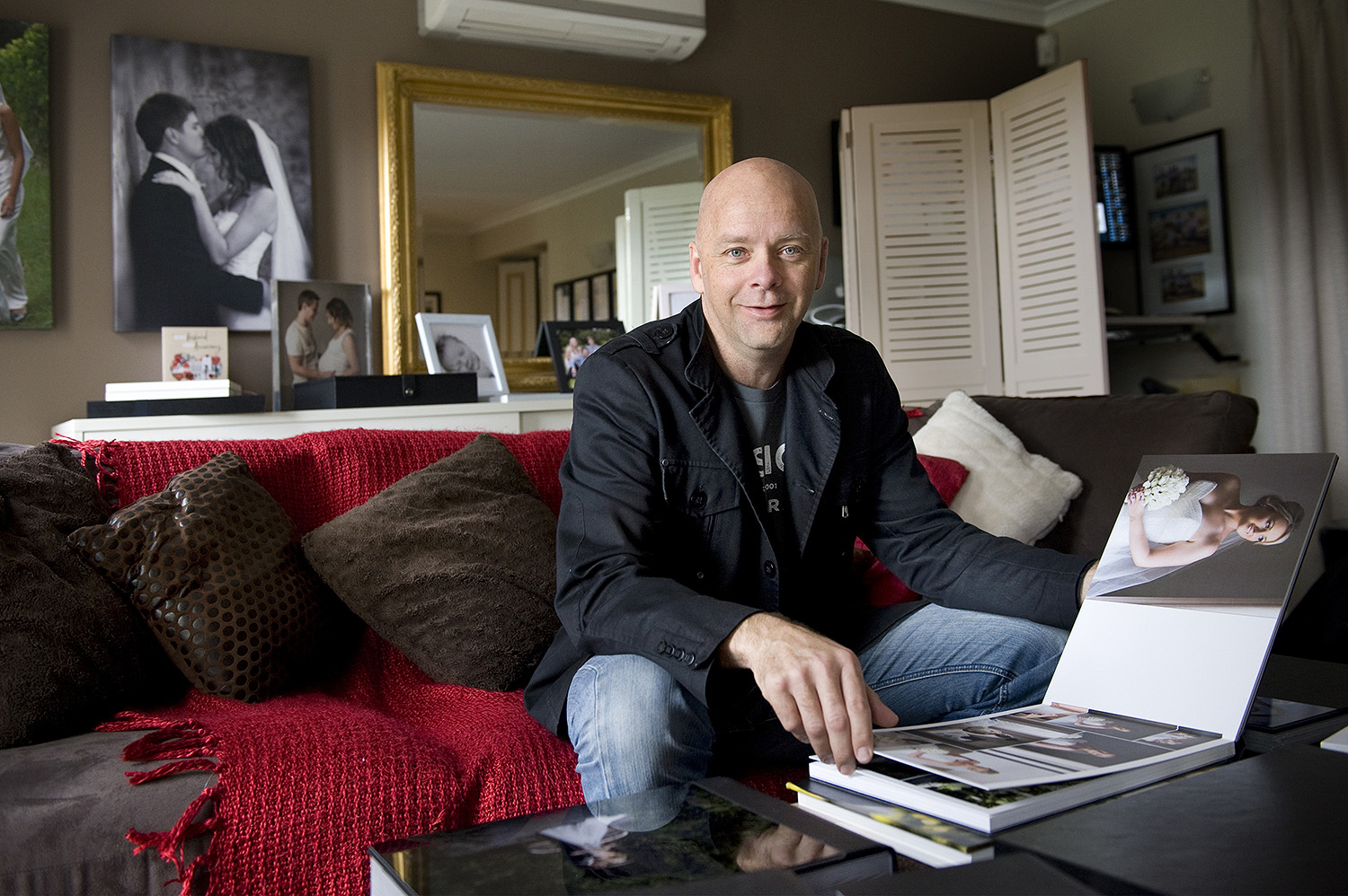 Wedding Photographer Andrew Harrison in his home studio viewing room