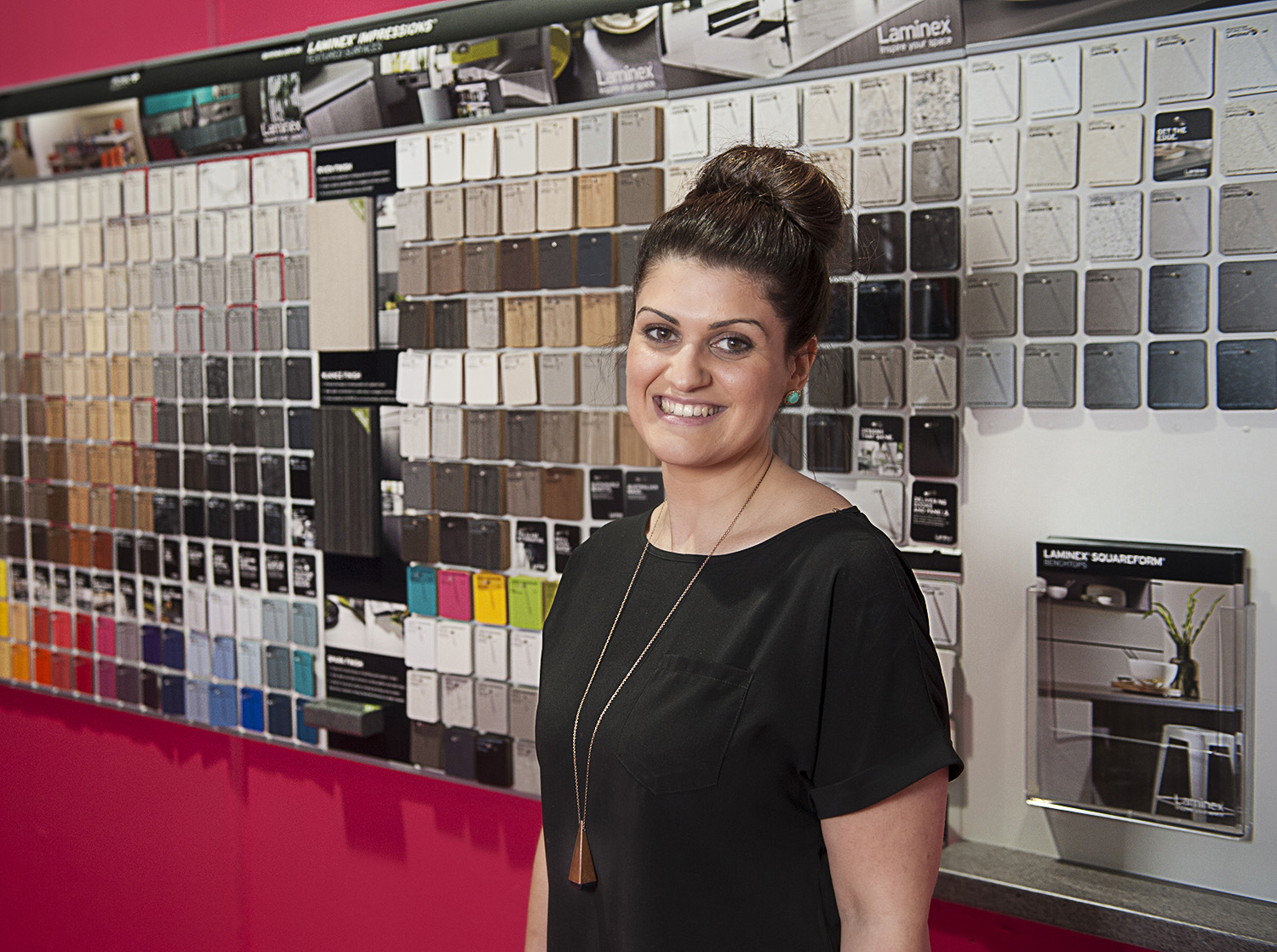 Interior designer and decorator Liana Corbino at her workplace with colour samples