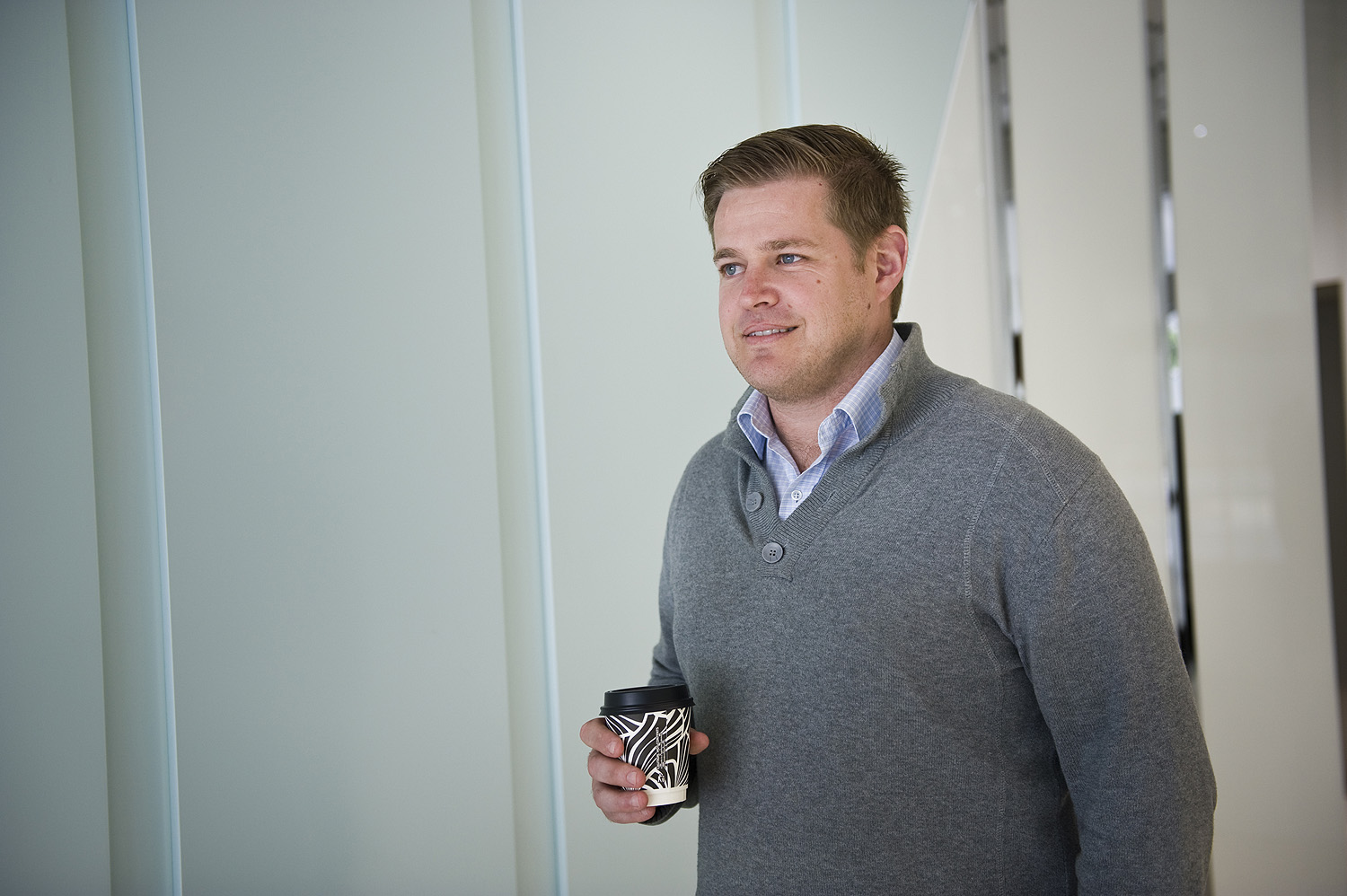 Scott Lambert Owner's Corporations Manager with his morning coffee
