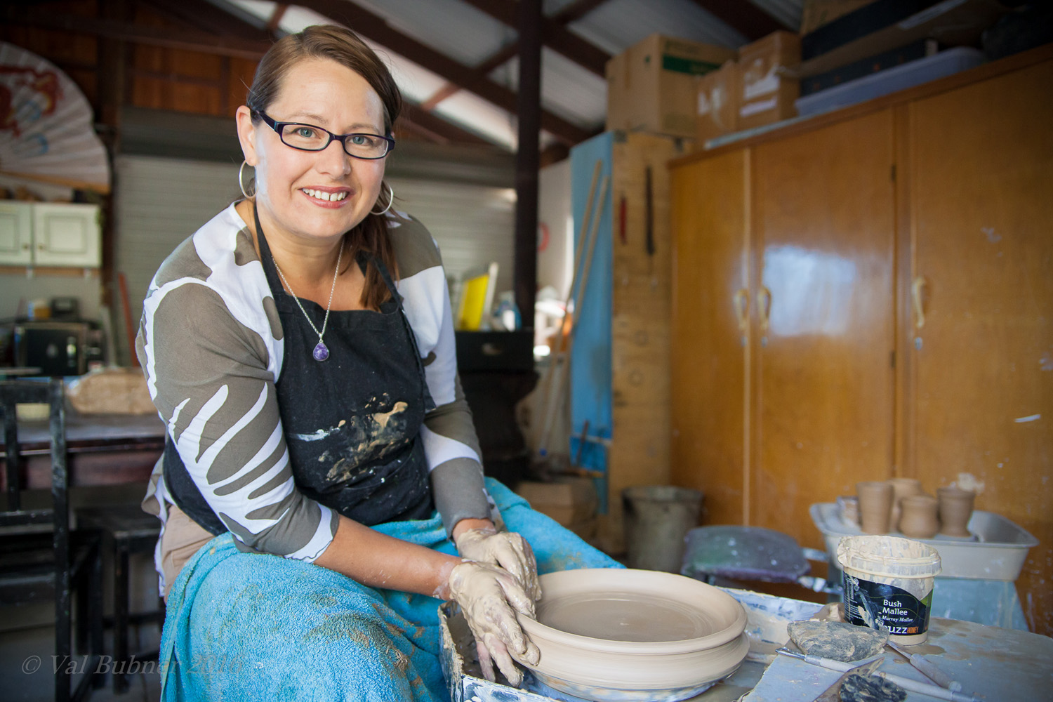 Tania Kunze a ceramic artist from Adelaide working on piece on the pottery wheel