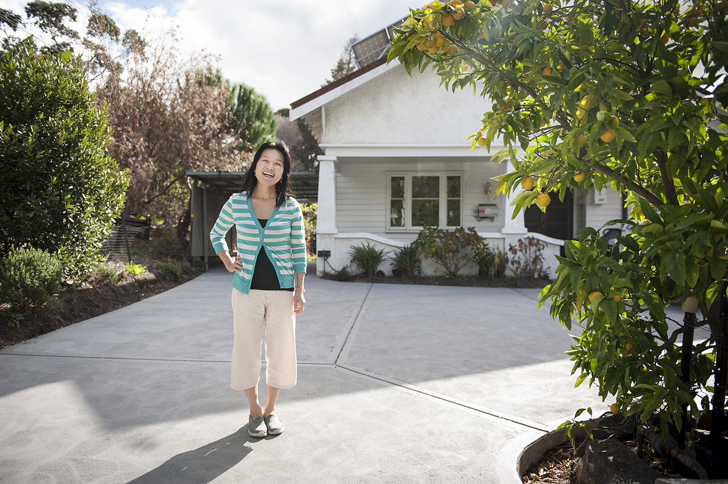 Property Investor tina koh in front of her home
