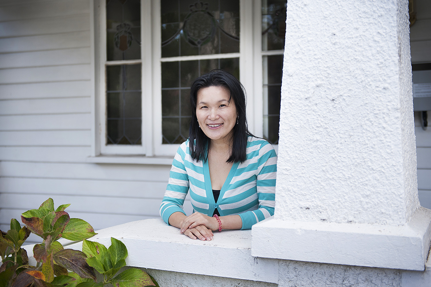 Property Investor tina koh on the porch of her bayside home